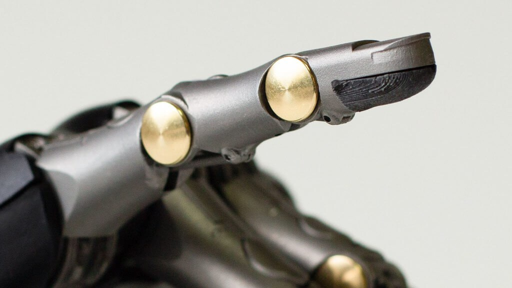 A closeup on one of the prosthetic fingers' joints and tip